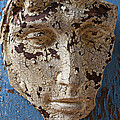 Cracked Face On Blue Wall by Garry Gay