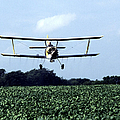 Crop Dusting by Photo Researchers