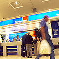 Currency Exchange At An Airport by Tony Mcconnell