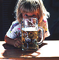 Cute Little Girl At Beer Garden Munich by Tom Wurl