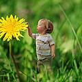 Cute Tiny Boy Playing In The Grass by Jaroslaw Grudzinski