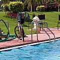 Cycle Near A Swimming Pool And Greenery by Ashish Agarwal