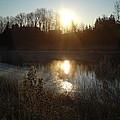 December Sunrise Off Smooth Water by Kent Lorentzen