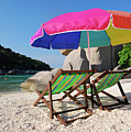 Deck Chairs On A Beach In Thailand by Thepurpledoor