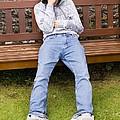 Depressed Teenage Boy On Park Bench. by Mark Williamson