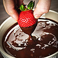 Dipping Strawberry In Chocolate by Elena Elisseeva