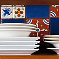 Dishes In Front Of Colorful Tile by Thom Gourley/Flatbread Images, LLC