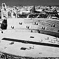 distant straight roman road leading through el Djem towards tourists the old roman colloseum arena by Joe Fox