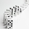 Dominoes Falling Over In A Chain Reaction by Larry Washburn