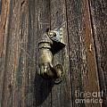 Door Handle In The Shape Of A Hand by Bernard Jaubert