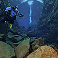 Dry Suit Divers In Gin Clear Waters by Mathieu Meur
