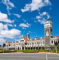 Dunedin Railway Station During A Sunny Day  by U Schade