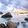 Dusk At Oze Rocky Shore by Tommy Tsutsui