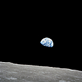 Earth Rising Above The Lunar Horizon by Stocktrek Images