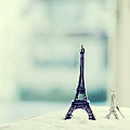 Eiffel Tower Still Life With Blurry Blue Backgroun by Kristy Campbell