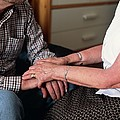 Elderly Couple Holding Hands by
