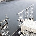 Electricity Pylons At Hydroelectric Dam by Ria Novosti