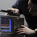 Electronics Technician Troubleshoots An by Stocktrek Images