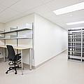 Empty Metal Shelves And Workstations by Jetta Productions, Inc