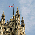 England, London, Union Flag Flown On Houses Of Parliament, Low Angle by Martin Child