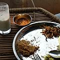 Enjoying A Plate Of Rajasthani Food On A Steel Plate On A Bamboo Table by Ashish Agarwal