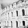 Entrance And Front Of The The Old Roman Colloseum Against Blue Cloudy Sky El Jem Tunisia by Joe Fox