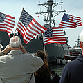 Family Members Wave Flags To Show by Stocktrek Images