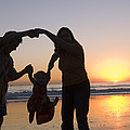 Family Portrait On The Beach At Sunset by Rich Reid