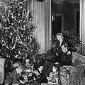 Family With Two Children (6-9) Sitting At Christmas Tree, (b&w) by George Marks