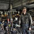 Farmer Working On Equipment by Dan Friend