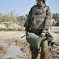 Female Airman Carries A Sandbag by Stocktrek Images