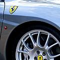 Ferrari Wheel And Emblems by Jill Reger