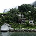 Few Houses On The Slope Of Mountain Next To Lake Lucerne In Switzerland by Ashish Agarwal