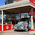 Filling Up The Old Ford Jalopy At The Associated Gasoline Station . Nostalgia . 7d12880 by Wingsdomain Art and Photography