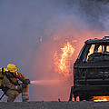 Firefighters Hosing A Burning Car by Duncan Shaw