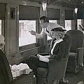 First Class Passengers In An by Everett