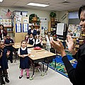 First Lady Michelle Obama Claps by Everett