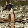 Fisherman Mekong 2 by Bob Christopher