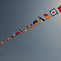 Flags Fly Over The Deck Of The Uss Iwo by Stocktrek Images