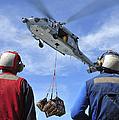 Flight Deck Personnel Wait For Supplies by Stocktrek Images