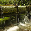 Flowing Water From Mill by Andrew Soundarajan