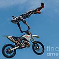 Flying High Motorcyle Tricks by Andrea Kollo