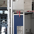 Food Compartment On An Airplane by Jaak Nilson