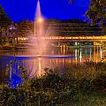 Fountain And Bridge At Night by John Herzog