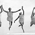 Four Dancers Leaping by Underwood Archives