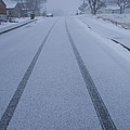 Fresh Tire Tracks In The Snow by John Burcham