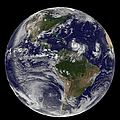 Full Earth Showing Two Tropical Storms by Stocktrek Images