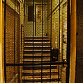 Gated Stairwell At Night by Mick Anderson