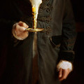 Gentleman In Vintage Clothing Holding A Candlestick by Jill Battaglia