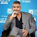George Clooney At The Press Conference by Everett